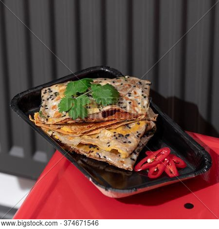 Top View Of Fried Chinese Pancake Or Fried Steamed Dumpling Made Of Garlic Chives, Rice Flour And Ta
