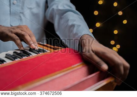 Hands Playing Indian Music Instrument Harmonium In Music Concert