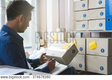 E Commerce Business Concept. Back View Of Business Owner Checking Ordered From Client In Application