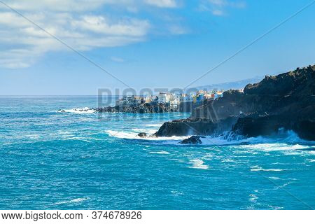 View On Ocean Shore And Colorful Buildings On The Rock In Punta Brava, Puerto De La Cruz, Tenerife,
