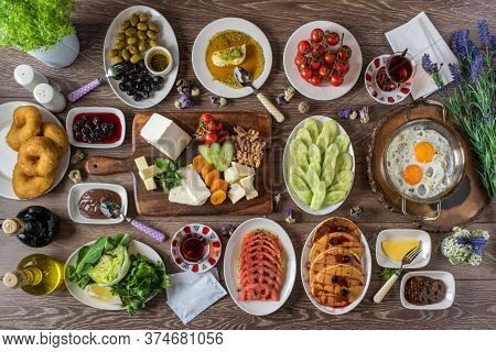 Traditional Turkish Breakfast Served With Traditional Turkish Tea On Wooden Table