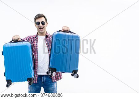 Concept Of Packing. Photo Of Happy Young Man Ready For The Trip With His Suitcase Packed Over White