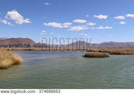 Titicaca Is A Large, Deep, Freshwater Lake In The Andes On The Border Of Bolivia And Peru, Often Cal