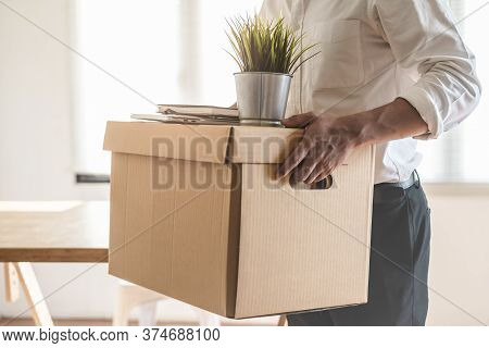Downsize Business. Employee Moving Off From Office After Sacked From Company.