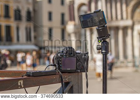 Venice, Italy 2 July 2020: Camera And Smartphone To Shoot Time Lapse