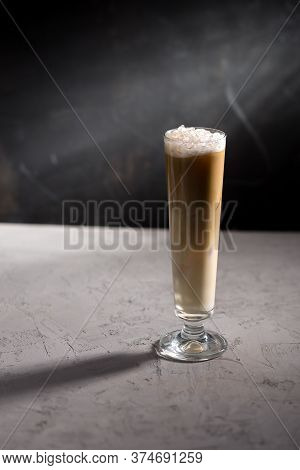 Summer Iced Coffee Frappuccino Frappe Or Latte In Tall Glass On Concrete Table On Black Background