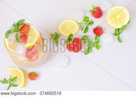 Bright Refreshing Drink For The Summer, Cold Strawberry Lemonade Juice In A Glass With Ice Cubes, To