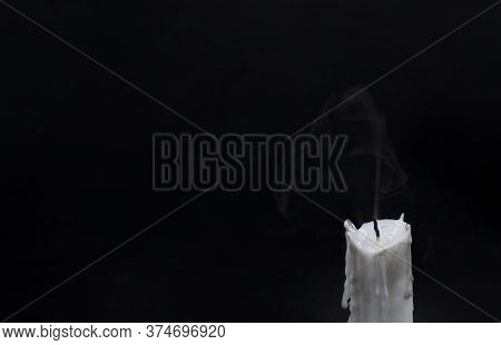 Extinguished Candle With Smoke. White Candle Wick Blow Out. Memory Photo. One Candle With Fire On Bl