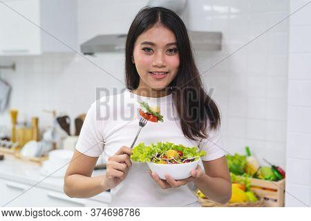 Eat Salad For Wellness. Young Girl Enjoy Eating Vegan.