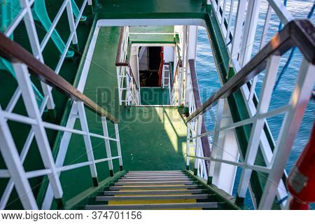 Ferry Or Cruise Boat Decks Connected With Stairs. Ferry Deck Upper And Lower Level. Budget Travel Op