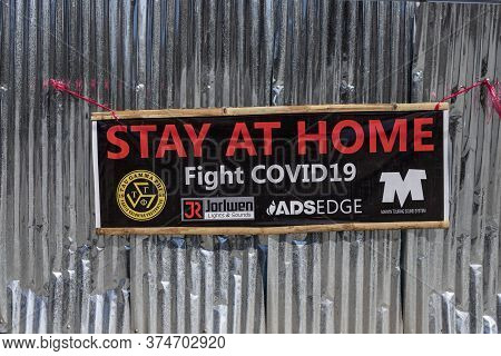 Dumaguete, The Philippines - 07 Apr 2020: Stay At Home Banner On Metallic Wall During Covid-19 Pande