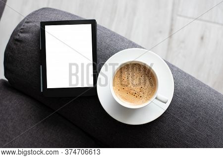 Mockup Ebook On Soft Modern Armchair With Blank White Screen, To Replace Your Design. Cup Of Coffee