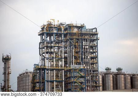 Pipeline System Of Oil Refinery Or Factory. Chemical Refinery. Structure Of Tanks For Oil Storage An
