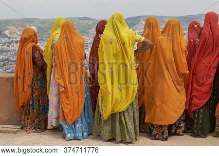 Jaipur, Rajasthan, India - July 30, 2008: Group Of Indian Women In Brightly Coloured Saris In A Rajp