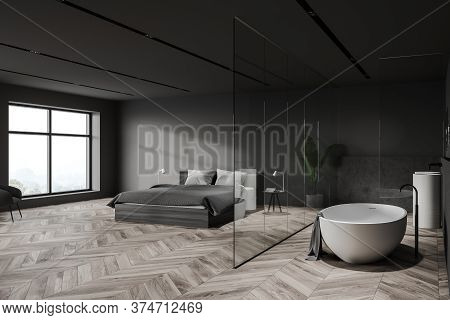 Corner Of Stylish Hotel Bedroom With Gray And Stone Walls, Wooden Floor, Comfortable King Size Bed A