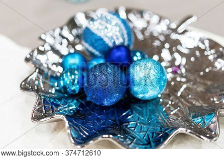 Shining Blue Christmas Decorations On Silver Plate. New Year Inspiration Still Life. Beautiful Still