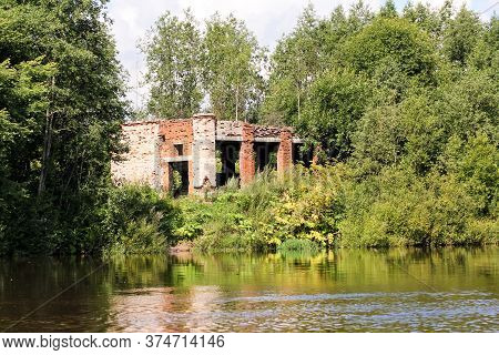 Old Ruins On The Shore. Nature On The Banks Of The Volkhov River.