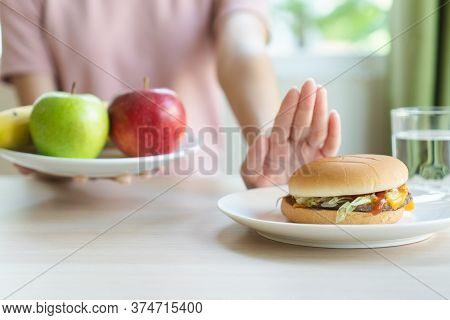 Woman On Dieting For Good Health Concept. Woman Doing Cross Arms Sign To Refuse Junk Food Or Fast Fo