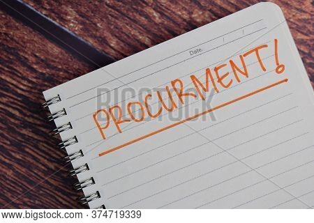 Procurment! Write On A Book Isolated Wooden Table.