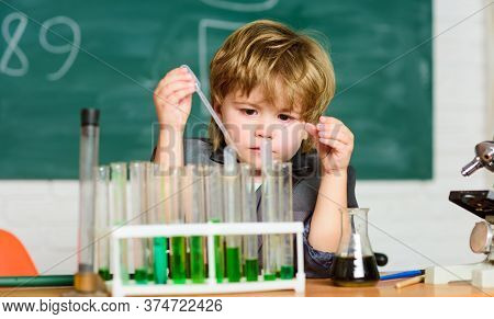 Chemistry Lab. Back To School. Little Boy At Chemical Cabinet. Kid In Lab Coat Learning Chemistry Ex