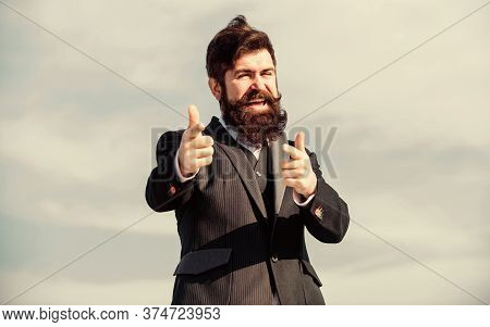 Happy Hipster. Charismatic Male. Bearded Man. Mature Hipster With Beard. Businessman Against The Sky