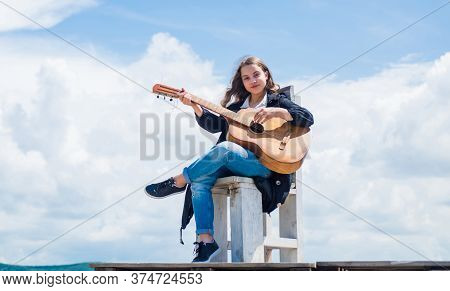 Guitarist Entertaining Guests At Party. Small Music Lover. Free Music Content. Teenage Musician Play