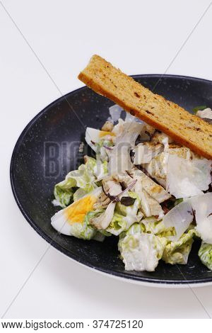 Caesar Salad Romain Lettuce, Boiled Egg, Anchovy And Bread Cruton