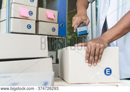 Close Up View Of Ecommerce Business Owner Preparing Goods To  Deliver To Customer.