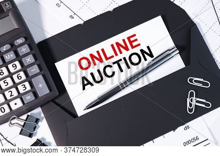 Online Auction. Text On A White Background Against A Black Envelope. Against A Calculator And White