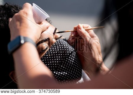 Rio De Janeiro, Brazil - July 3, 2020: Young Woman In Protective Mask Is Having A Procedure Of Micro