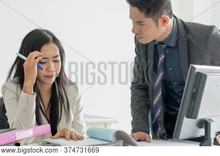 Bad Leadership Management. Asian Boss / Manager Shouting To Female Employee At Desk In Office And Up