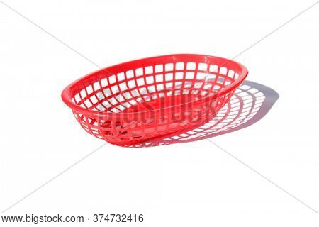 Plastic Burger Basket. Red plastic fast food Lunch or Dinner basket. Plastic basket isolated on white. Room for text. Plastic Baskets are used to serve Hamburgers, Hot Dogs, Fried Chicken, and more.