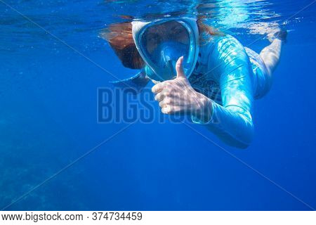 Woman In Snorkeling Mask Underwater Photo. Female Snorkel Show Thumb Undersea. Snorkeling In Tropica
