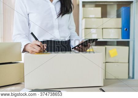 E Commerce Business Concept. Business Woman Checking Ordered From Client In Application In Mobile Ph