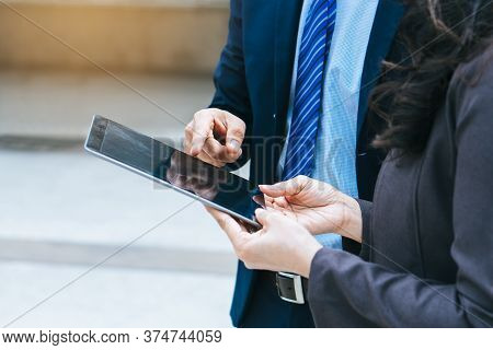 Modern Gadget In Business Company. Businessman Reviewing Budget Information In Touchpad.