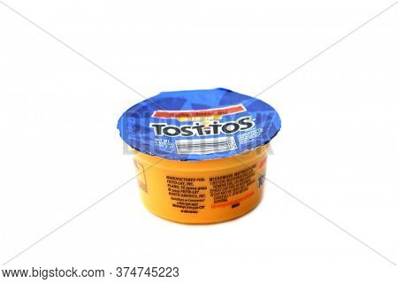 Lake Forest, CA / USA - July 1, 2020: Tostitos Nacho Flavor Cheese Sauce. A unopened package of Nacho Cheese Sauce. Isolated on white. Room for text. Editorial Use. Cheese Sauce is enjoyed world wide.