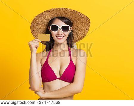 Young Beautiful Woman Wearing Swimsuit Bikini And Showing Credit Card