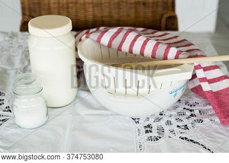 Yoghurt And Salt With Mixing Bowl And Wooden Spoon For Labenah