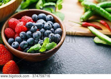 Blueberries And Strawberries In A Bowl For Healthy Food