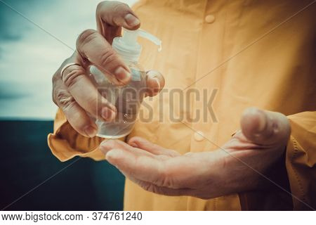 male hands with antiseptics during a pandemic