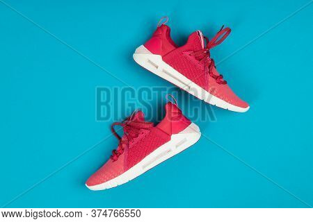 Pair Of New Pink Sneakers, Sport Shoes On Blue Background. Pink Womens Sport, Running Shoes