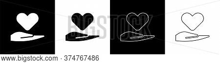 Set Heart On Hand Icon Isolated On Black And White Background. Hand Giving Love Symbol. Valentines D