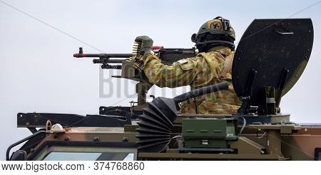 Avalon, Australia - February 27, 2015: Australian Army Soldier With Large Machine Gun In The Turret