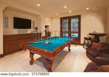 Billiards table in games room