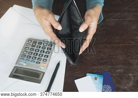 Woman Have A Financially Broke From Due Of Credit Card Debt Payday. Person Opening Empty Wallet No M