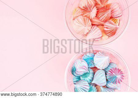 Soft Pink And Blue  Color Mini Marshmallows Dessert In Plastic Glasses Top View, Flat Lay Style. Con