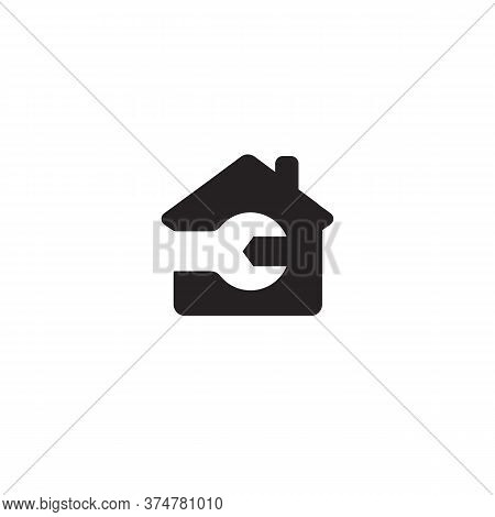 Repair Logo Concept. Black House Silhouette With Wrench Inside, Negative Space Logotype. Auto Repair