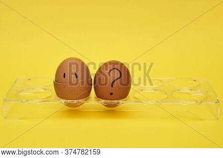 Chicken Eggs In An Egg Stand. Tray For Eggs. Half An Egg, Egg Yolk, Shell. Emotions And Facial Expre