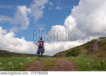 Woman Hiking In Nature In Mountain. Traveling In Nature. Woman Hiking Outdoor Backpacking In Nature.