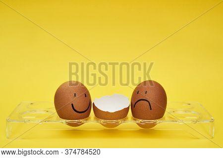 Chicken Eggs In An Egg Holder. Full Tray Of Eggs. Half An Egg, Egg Yolk, Shell. Emotion And Facial E
